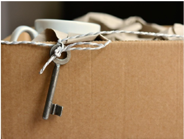 items packed in a cardboard box with a key