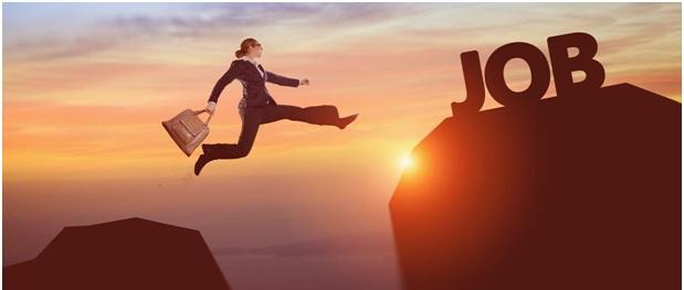 woman jumping towards the job mountain